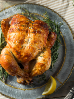 featured image showing a finished and cooked rotisserie chicken.