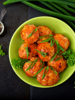 Featured image showing a bowl full of meatballs to represent recipes using ground chicken.