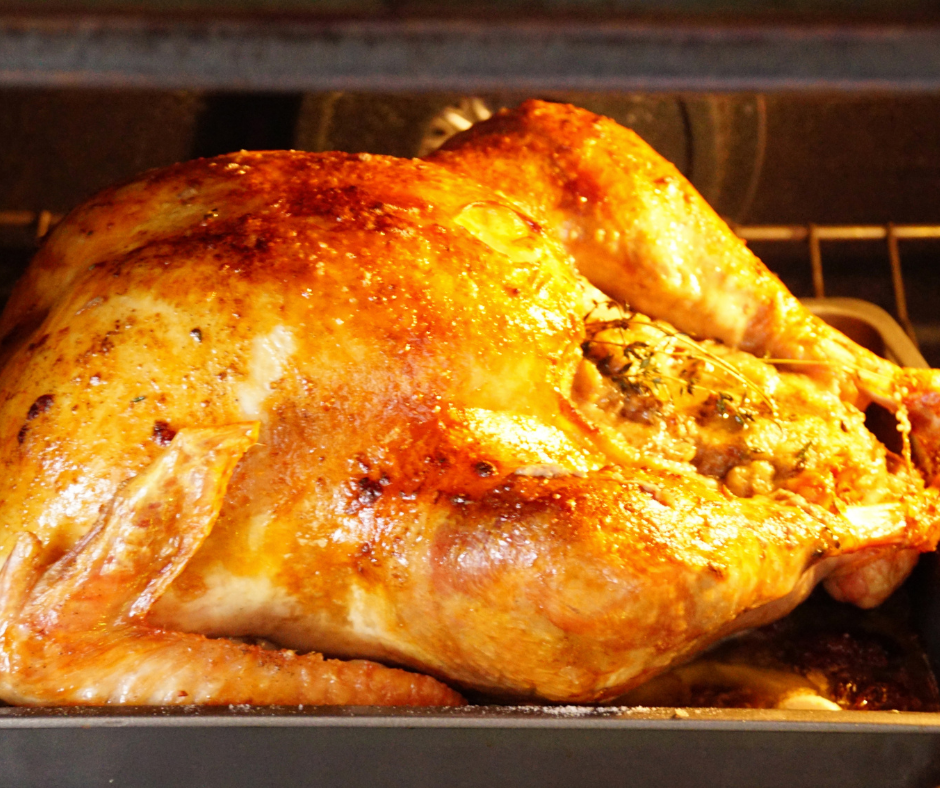 A turkey roasting in the oven.