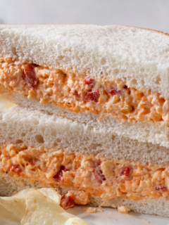 featured image showing pimento cheese recipes on bread with chips.